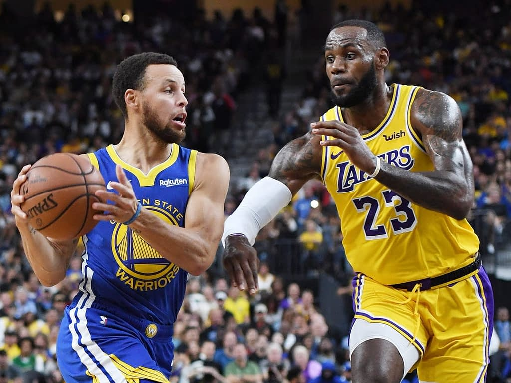 LeBron James and Stephen Curry battle it out in a NBA match