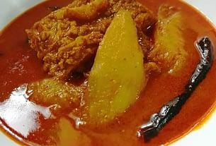 Raw mango and rohu fish broth