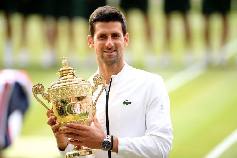 Novak Djokovic with his Wimbledon Men's Singles winners trophy in 2019