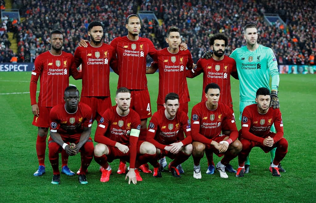 Liverpool players line up for a photo before a match